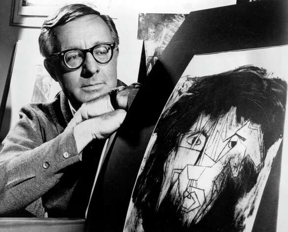 This Dec. 8, 1966 file photo shows science fiction writer Ray Bradbury looking at a picture that was part of a school project to illustrate characters in one of his dramas in Los Angeles.  Bradbury, who wrote everything from science-fiction and mystery to humor, died Tuesday, June 5, 2012 in Southern California. He was 91. (AP Photo, file) Photo: Associated Press / AP1966