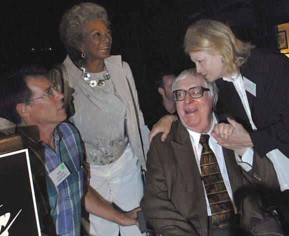 "Science fiction author Ray Bradbury, right, enjoys an 83rd birthday celebration in his honor with actresses Angie Dickinson, right, and ""Star Trek"" veteran Nichelle Nichols, along with science fiction author Kim Stanley Robinson, Saturday, Aug. 23, 2003, at The Planetary Society in Pasadena, Calif. Photo: STEFANO PALTERA, AP / AP"