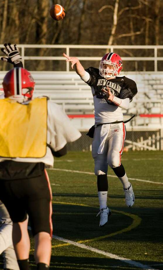 New Canaan High School quarterback Turner Baty, right, practices with the team for the Thanksgiving day game against Darien High School. Photo: Kerry Sherck / Stamford Advocate