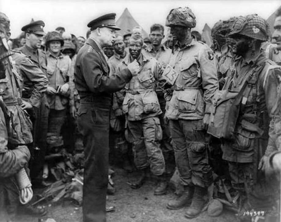 """The eyes of the world are upon you,"" Supreme Allied Commander Dwight D. Einsenhower told troops that day. ""The hopes and prayers of liberty-loving people everywhere march with you ..."" Here he is shown addressing troops personally a day before the invasion."