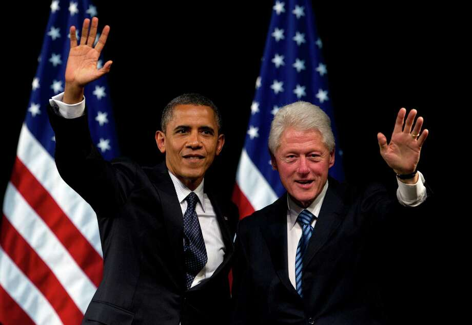 President Barack Obama and former President Bill Clinton share a stage in June. The camps have traded second-guessed each other and traded barbs. Photo: Carolyn Kaster, Associated Press / AP