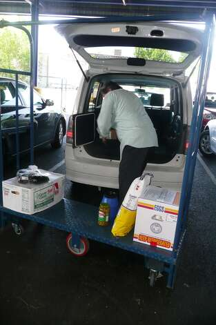 Chef Jean-Louis Gerin loads up the van after shopping at Restaurant Depot in Port Chester, N.Y. for his Greenwich Restaurant Jean-Louis. Photo: Anne W. Semmes