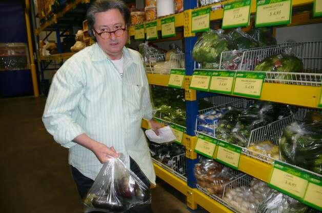 Chef Jean-Louis Gerin does picks up eggplants at Restaurant Depot in Port Chester, N.Y. for his Greenwich Restaurant Jean-Louis. Photo: Anne W. Semmes