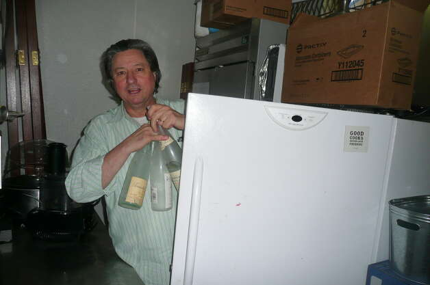Chef Jean-Louis Gerin stores bottles in his Greenwich Restaurant Jean-Louis. Photo: Picasa, Anne W. Semmes