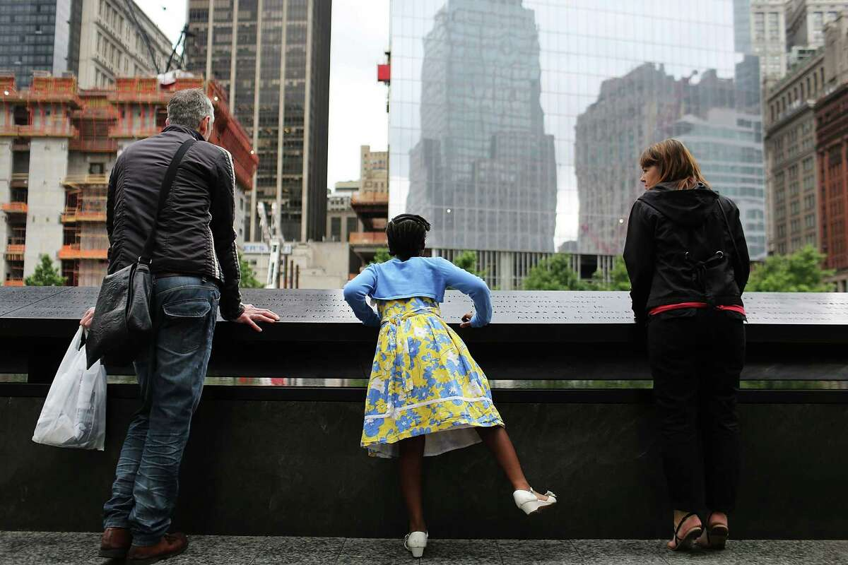 NEW YORK, NY - JUNE 05: Justis Suggs, 8, looks into the 9/11 memorial pool while visiting the Ground Zero site with other area students as part of the Penny Harvest for the 9/11 Memorial campaign on June 5, 2012 in New York City. The students from all five New York City boroughs gathered at the memorial site to present a check for $57,000, to support the conservation of the Survivor Tree, a callery pear pulled from the rubble of the World Trade Center site after the 2001 attacks. The campaign began in September 2011 and encouraged students from over 200 schools to donate a penny to the National September 11 Memorial & Museum. The program looked to get children to reflect on the history and significance of the 2001 attacks. (Photo by Spencer Platt/Getty Images).