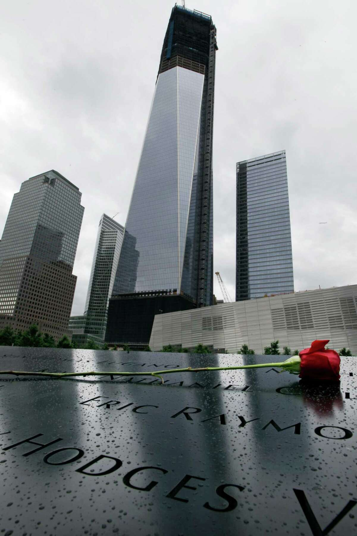 A rose is placed near names inscribed on the south pool at the National September 11 Memorial on Tuesday, June 5, 2012, in New York.