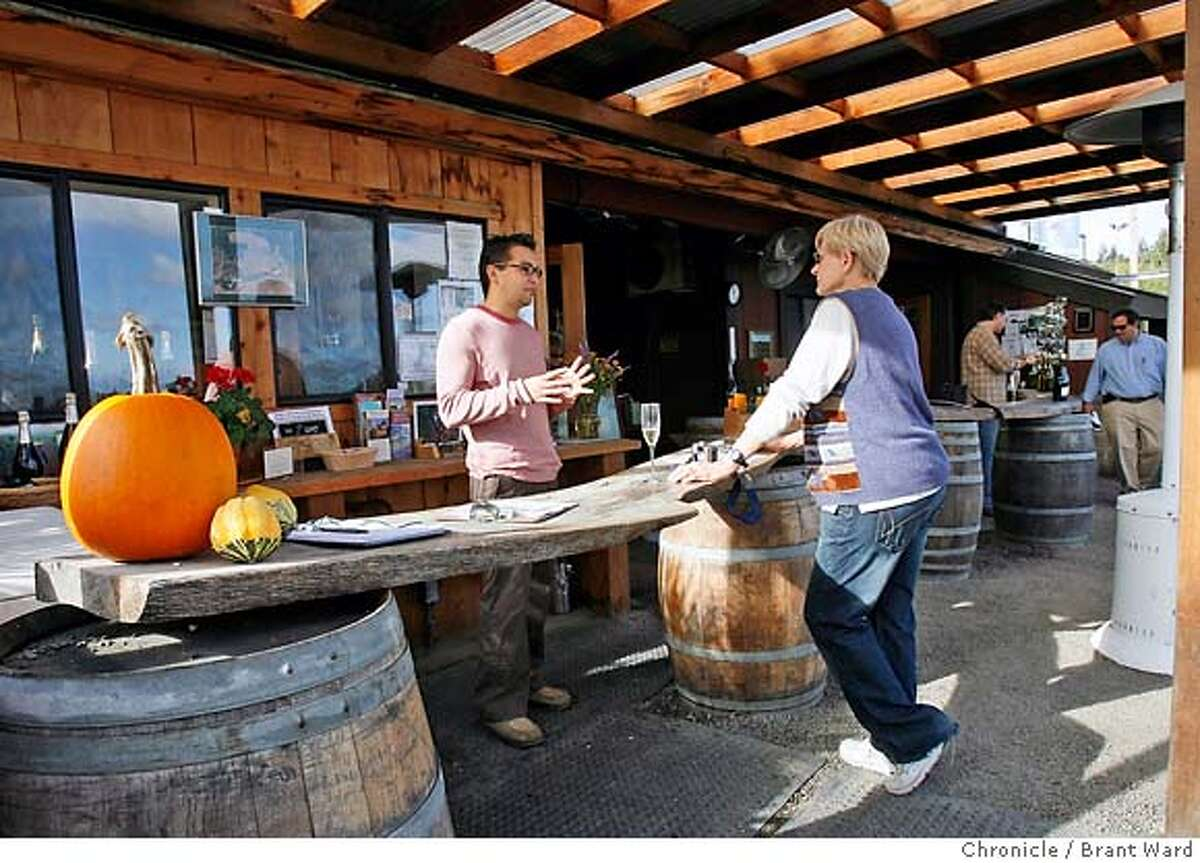 tastingrooms023.JPG At Iron Horse Vineyards, the tasting room is outdoors...here Charlotte Underwood from Missouri gets instructed by Damon Wong, left, on fine sparking wines. Three tasting room reviews in the North Bay located in the Russian River and Dry Creek Valleys. Iron Horse Vineyards on Ross Station Road, Sebastapol, features an outdoor tasting room. J. Rochioli Vineyards on Westside Road in Healdsburg has a warm, friendly tasting room with nice views and Roshambo Winery for the Generation X wine drinkers features an ultra modern tasting room. {Brant Ward/San Francisco Chronicle}11/21/06