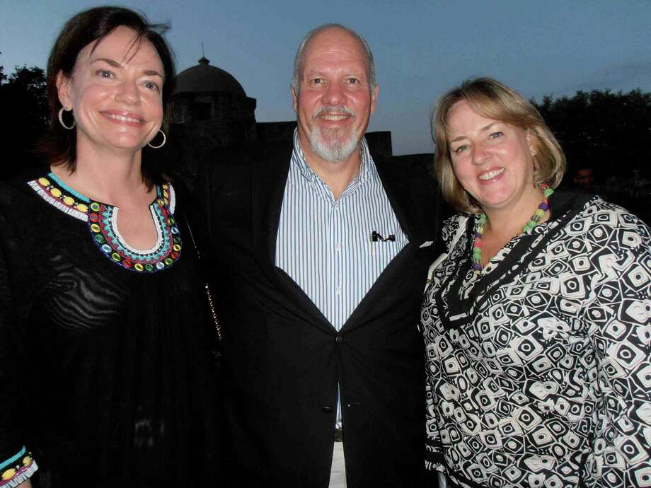 Ruth Agather, from left, her husband, John Agather, and Katie Luber enjoy a spectacular sunset at a dinner celebrating the 40th anniversary of UNESCO's World Heritage Conventions. The dinner was part of the convention, held in San Antonio. Photo: Nancy Cook-Monroe