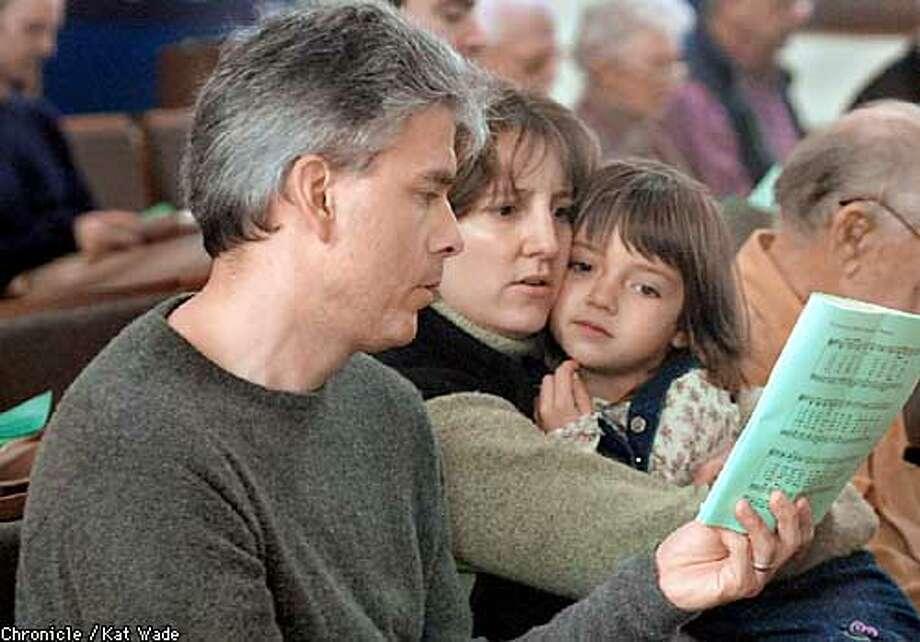 Vestry member Nico van Aelstyn (CQ) (Left) sits with his wife Sarah Lawton, and daughter, Hannah van Aelstyn, 5, during Sunday service at The Episcopal Church of Saint John the EvangeADEUS������������������������������������������� Photo: KAT WADE
