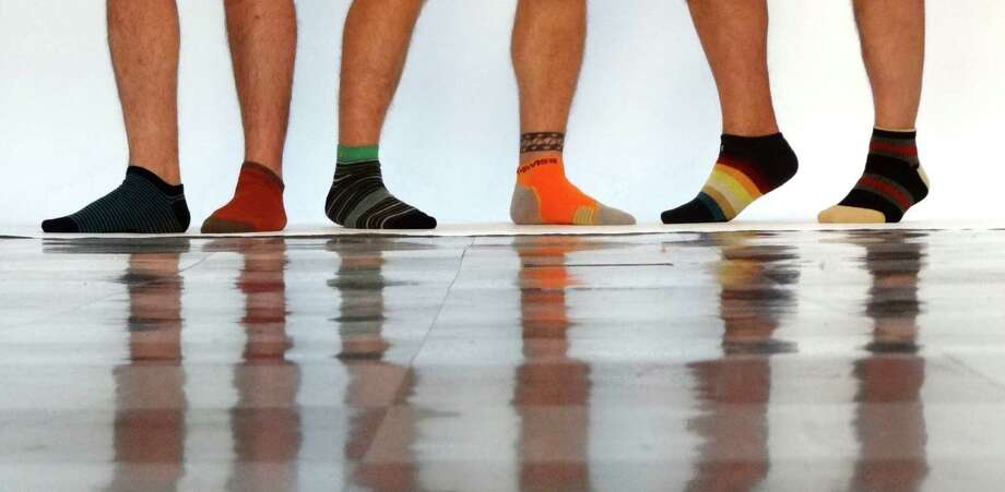 This Father's Day, remember that socks don't have to be black and brown. Photo: Billy Calzada, San Antonio Express-News / © 2012 San Antonio Express-News