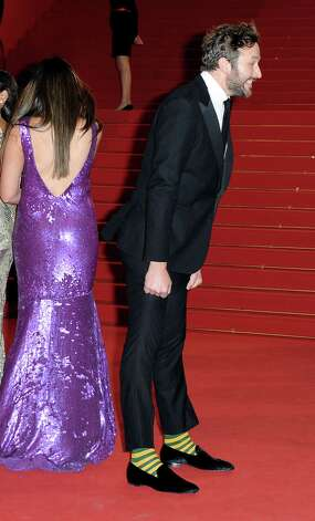 Actor Chris O'Dowd shows off his rock-'em-sock-'em socks at the Cannes Film Festival. Standout socks bring attention to any outfit. Photo: Pascal Le Segretain, Staff / 2012 Getty Images