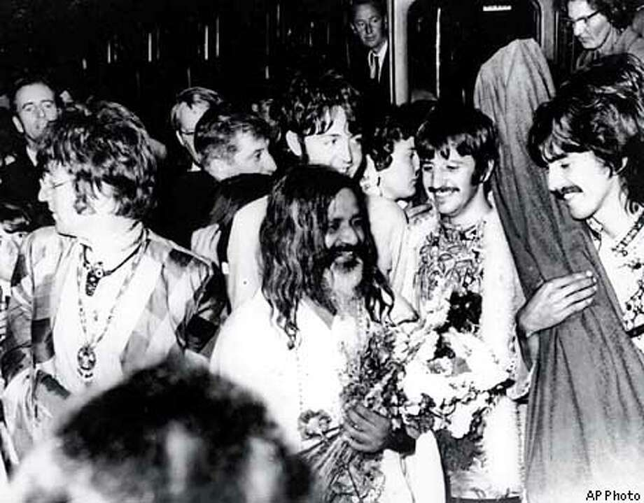 FILE--The Beatles join the Maharishi Mahesh Yogi, center, as they arrive by train at Bangor, Wales, to participate in a weekend of meditation, in this Aug. 26, 1967, file photo. From left to right are, John Lennon, Paul McCartney, Ringo Starr and George Harrison. Harrison died Thursday Nov. 29, 2001, a longtime family friend said. He was 58. The Maharishi is the founder of the International Meditation Society. (AP Photo)