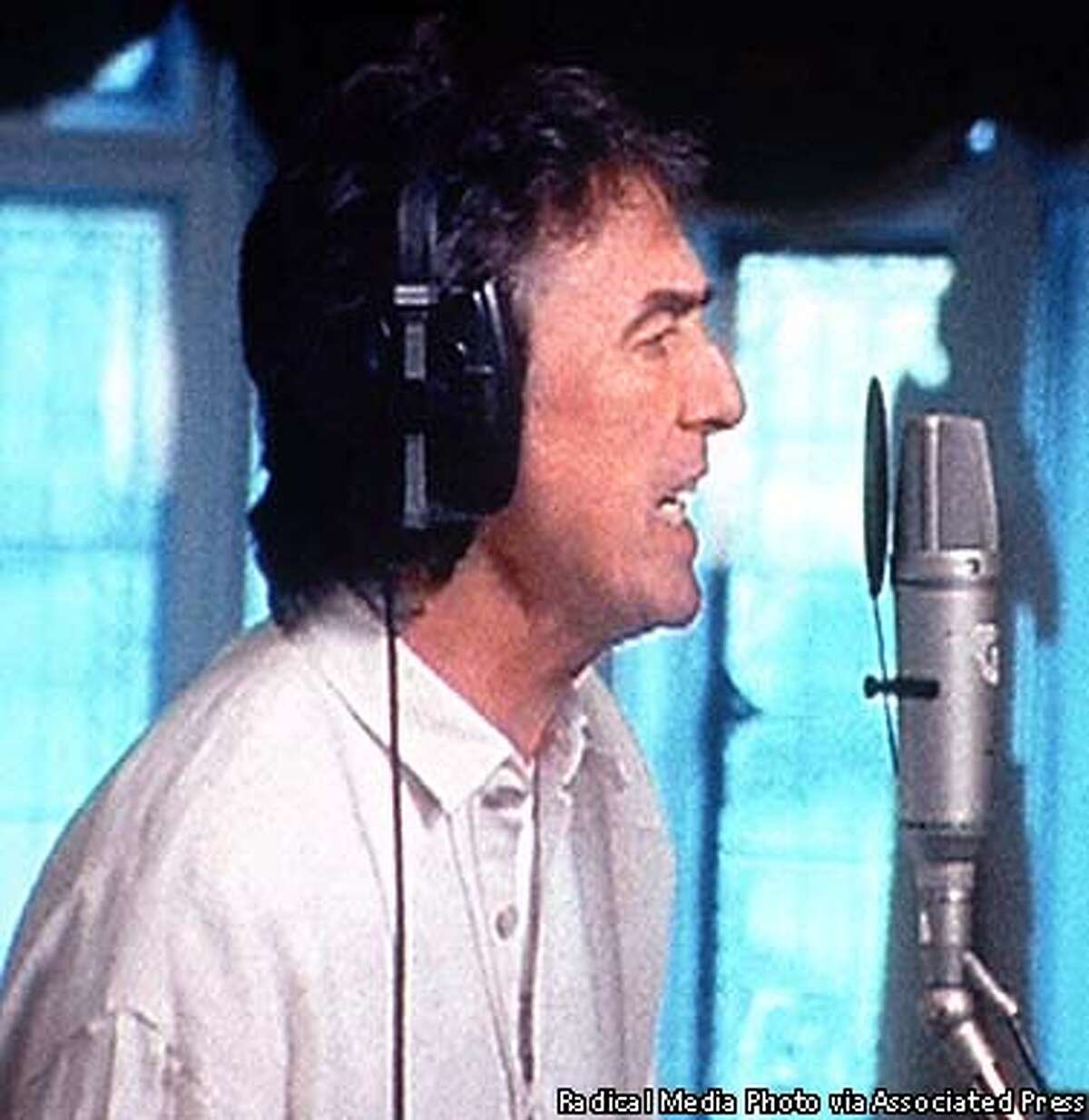 """FILE--George Harrison records the song """"My Sweet Lord"""" in his home studio outside London in this undated photo. Harrison died Thursday Nov. 29, 2001, a longtime family friend said. He was 58. (AP Photo/@radical.media, Inc., HO)"""