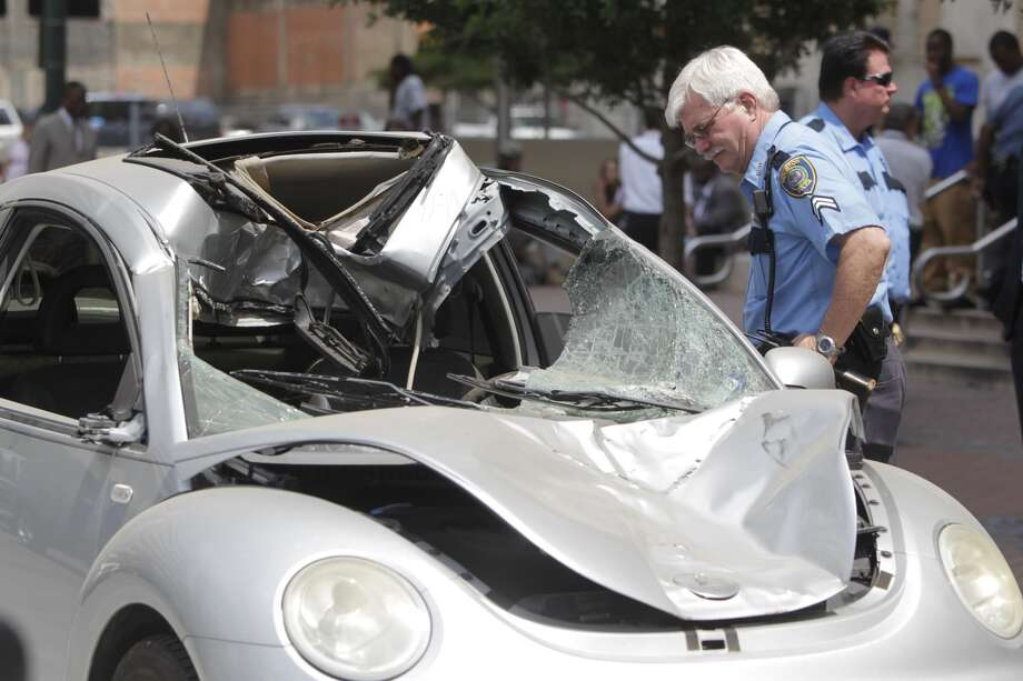 The car that Johoan Rodriguez was driving when he struck and killed HPD officer Kevin Will last year was brought to the front of the Criminal Justice Center Wednesday so jurors could view it. Photo: Mayra Beltran, Houston Chronicle