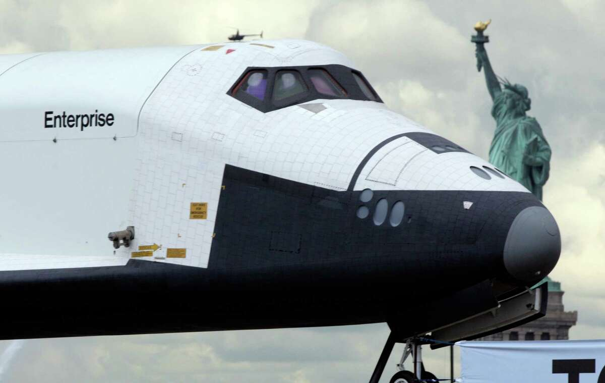 The space shuttle Enterprise is makes the final leg of its journey to its new Manhattan home on the flight deck of the Intrepid Sea, Air & Space Museum. Wednesday. (AP Photo/Richard Drew)