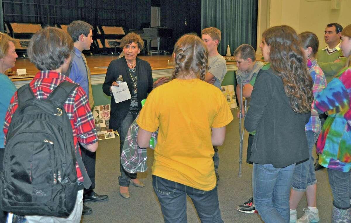 Anita Schorr talks with Middlesex Middle School seventh grade students in Darien, Conn.