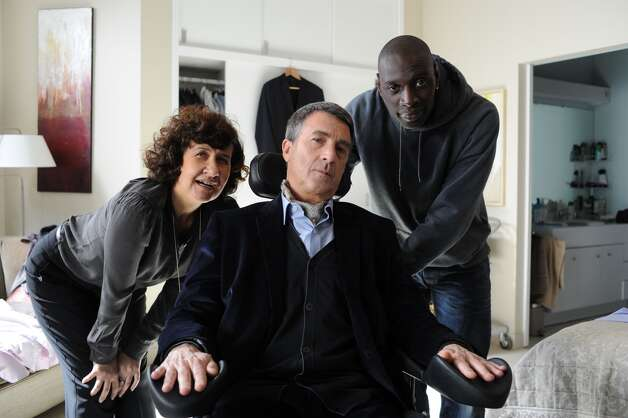 "Anne Le (from left), Francois Cluzet and Omar Sy star in ""The Intouchables,"" a French comedy that opens here today. Photo: The Weinstein Co."