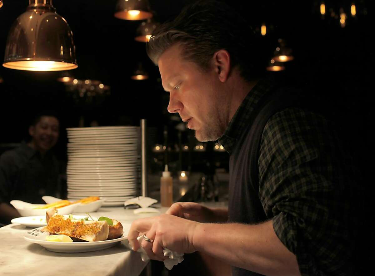 Tyler Florence puts the finishing touches on the trencherman's plate of beef and bones, Thursday January 13, 2011, at the Rotisserie and Wine restaurant in Napa, Calif.