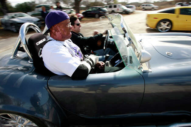 Wounded Army soldier Javier Ivan Rivera goes for a ride in a replica Cobra with car owner Ken Williams of Houston on December 13, 2008. Rivera served in the U.S. Army in Afghanistan when he was wounded in November of 2007. Rivera joined other soldiers as part of Operation Comfort's Automotivation program that offers an opportunity for soldiers to work on vehicles as part of their recovery and therapy from their injuries. On this particular day, club members from various Cobra replica associations in Texas drove their vehicles to South San Antonio to offer rides and give gifts of appreciation to the soldiers. Kin Man Hui/kmhui@express-news.net Photo: Kin Man Hui, San Antonio Express-News / San Antonio Express-News