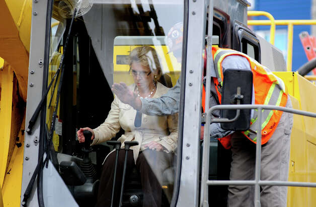 Governor Chris Gregoire is taught how to use an excavator during the SR 99 Tunnel Project groundbreaking ceremony. Photo: LINDSEY WASSON / SEATTLEPI.COM