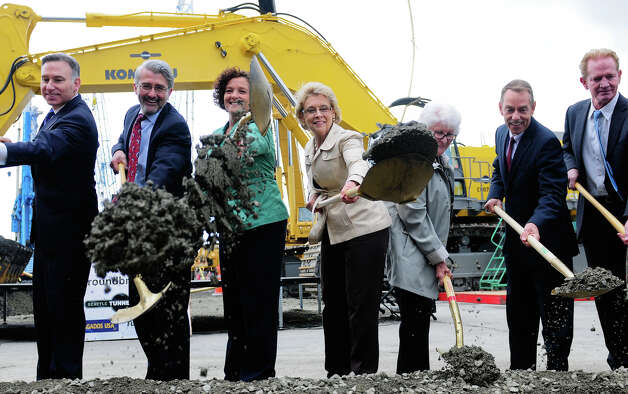 City officials perform the ceremonious dirt tossing during the SR 99 Tunnel Project groundbreaking on 1st Ave S. near the waterfront on Wednesday, June 6, 2012.   (Photo by Lindsey Wasson). Photo: LINDSEY WASSON / SEATTLEPI.COM