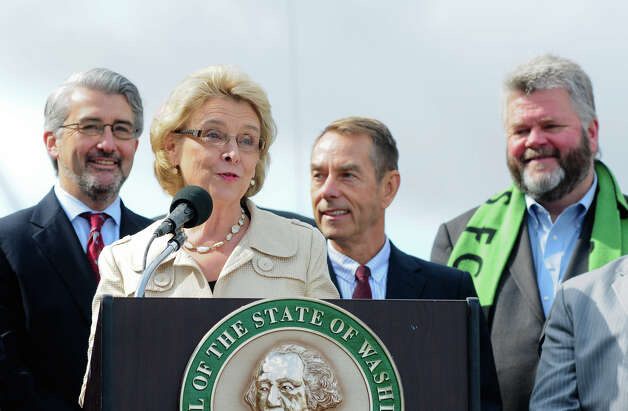 Gov. Chris Gregoire gathers with Seattle officials including former Seattle Mayor Greg Nickels, right, at the SR 99 Tunnel Project groundbreaking ceremony on 1st Ave S. near the waterfront on Wednesday, June 6, 2012.