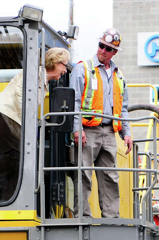 Governor Chris Gregoire smiles to the crowd as she exits the excavator during the SR 99 Tunnel Project groundbreaking ceremony. Photo: LINDSEY WASSON / SEATTLEPI.COM