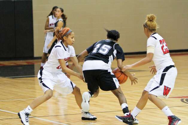 Wagner twins Adriane and Aundrea Davis double-team a Steele player during a game. Photo: Courtesy Photo