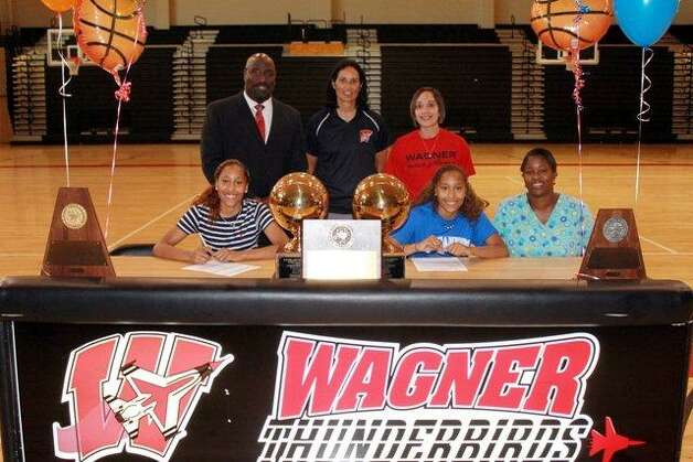 Wagner High School basketball players Aundrea and Adriane Davis each signed letters of intent to play college ball. Aundrea has signed with South Plains College while twin sister Adriane will play for Blinn College. The sisters are three-year Wagner lettermen, All-Academic and were selected to the First team 25-5A All-District team. The twins were an integral part in leading Wagner to the UIL state semi-finals and three district championships. Photo: Courtesy Photo, Judson ISD