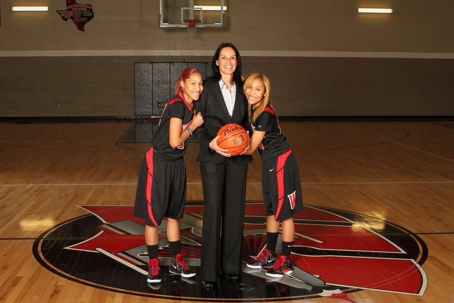 Twins and Wagner basketball players Adriane and Aundrea Davis poses with their coach, Christina Camacho. Photo: Courtesy Photo