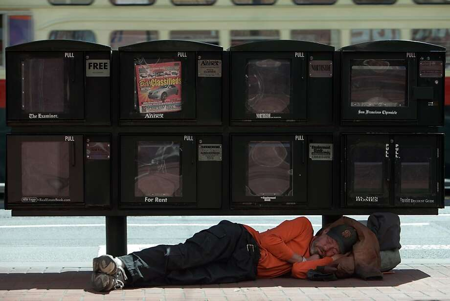 A man sleeps on the sidewalk on Market Street, April 1, 2011 in San Francisco, Calif.  Photograph by David Paul Morris/Special to the Chronicle Photo: David Paul Morris, Special To The Chronicle