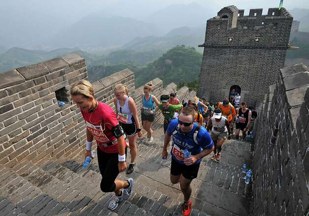 Runners compete in the Great Wall marathon at Huangyaguan (Yellow Cliff Pass) Great Wall of China in Tianjin on May 19, 2012.  The annual race attracts more than 1,600 athletes from 49 countries and is regarded as one of the most challenging marathons in the world.    CHINA OUT     AFP PHOTOSTR/AFP/GettyImages Photo: Str, AFP/Getty Images