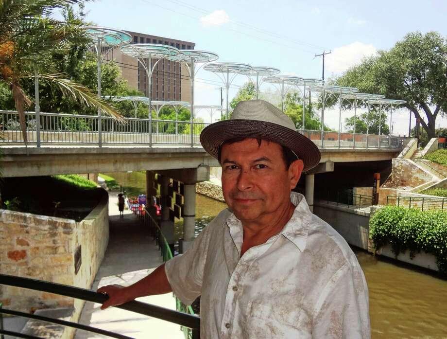 "San Antonio artist Rolando Briseno created ""Puente de Rippling Shadows,"" a public art piece on the Brooklyn Street bridge. Photo: STEVE BENNETT, SAN ANTONIO EXPRESS-NEWS / SBENNETT@EXPRESS-NEWS.NET"