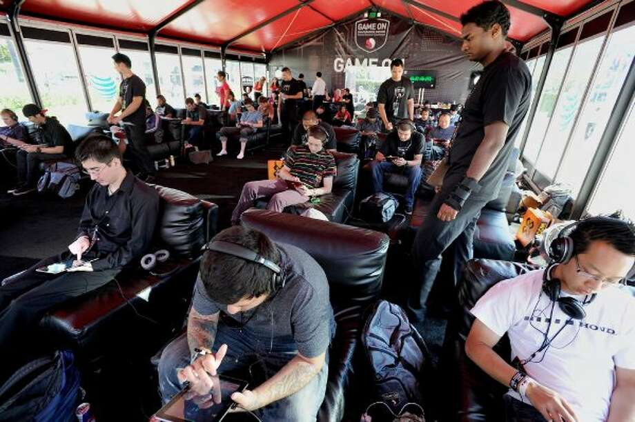 "COMMERCIAL IMAGE - In this image provided by Qualcomm - Players compete during the Qualcomm  E3 Snapdragon Gaming World Record Challenge in a the Guinness Book of World Records for ""Longest video games marathon on a tablet"" on Tuesday June 5, 2012, in Los Angeles. (Photo by Eric Reed/Invision for Qualcomm/AP Images) (INVISION FOR QUALCOMM/AP IMAGES)"