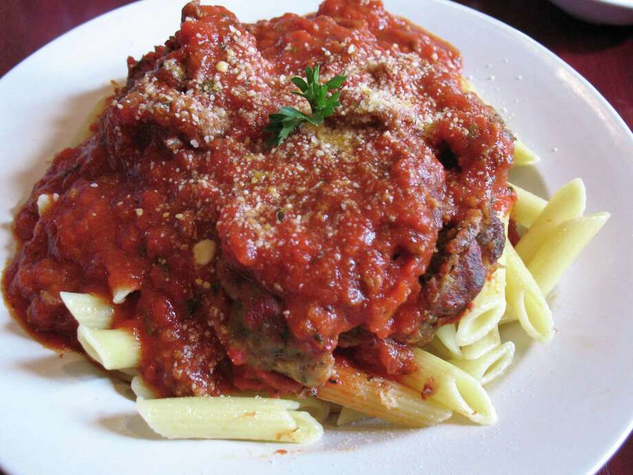 Penne and meatballs at DiLiberto's Restaurant and Bakery. Photo: JENNIFER MCINNIS, SAN ANTONIO EXPRESS-NEWS / JMCINNIS@EXPRESS-NEWS.NET