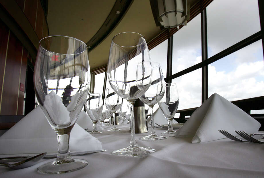 The table settings at the Tower of the Americas at Landry's Eyes Over Texas Fine Dining Restaurant, reflects the airiness of the restaurant. Photo: Bob Owen, SAN ANTONIO EXPRESS-NEWS / San Antonio Express-News