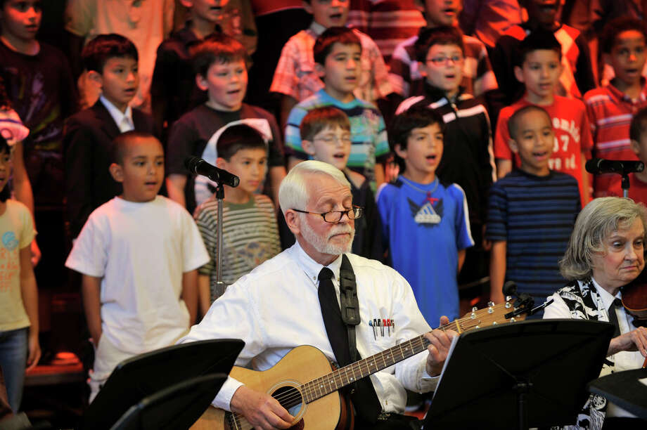 Barry Finch plays guitar during a musical concert combining the Senior Melodiers from Founder's Hall in Ridgefield and third-graders at Ellsworth Avenue School in Danbury, Conn., on Wednesday, June 6, 2012. Photo: Jason Rearick / The News-Times