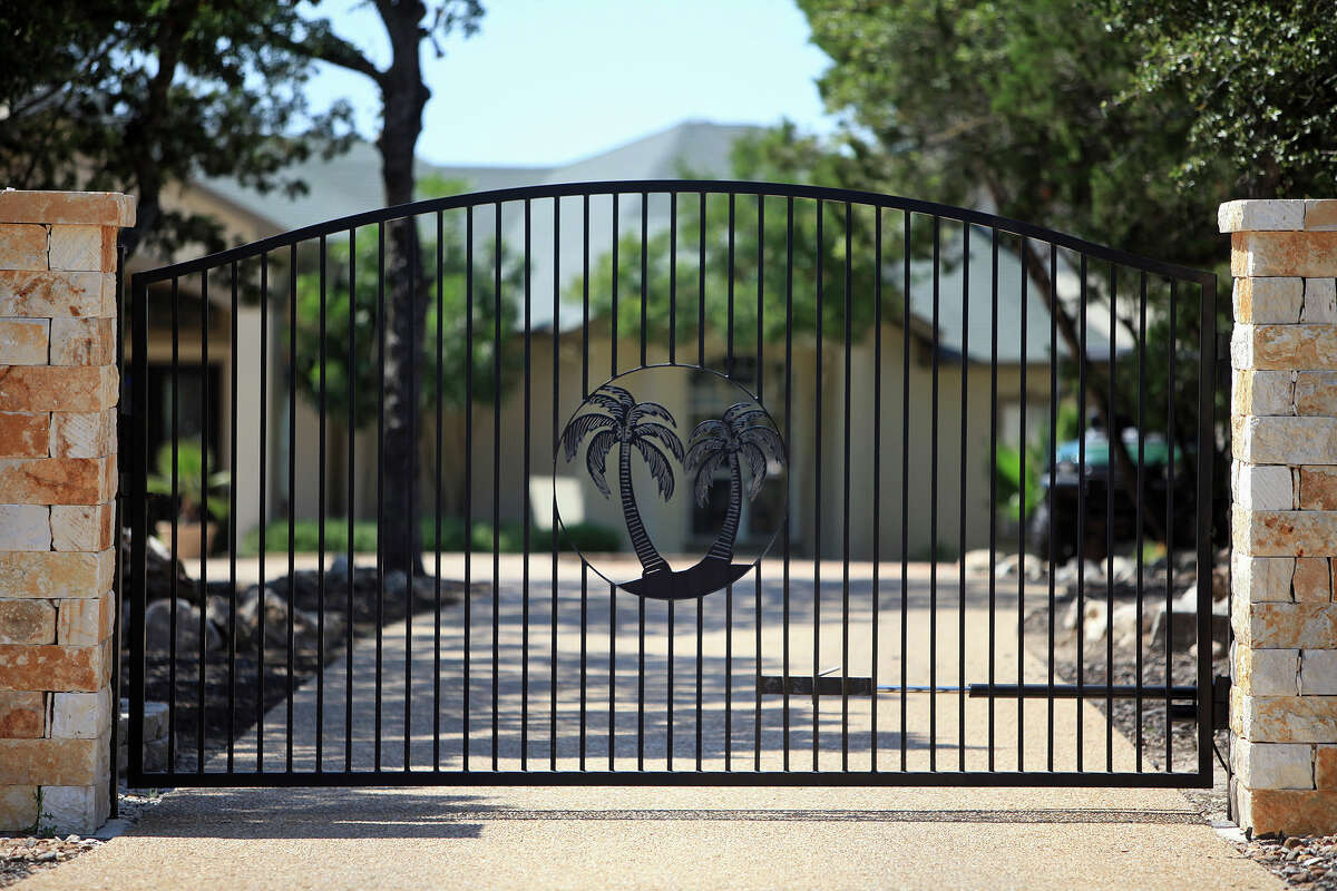 Wrought iron fence and gate at the entrance of Billy Mayes' home in Bulverde on Saturday, June 2, 2012.