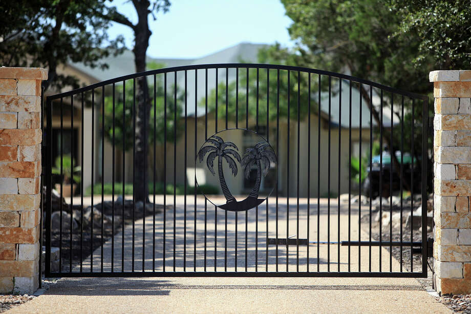 Wrought iron fence and gate at the entrance of Billy Mayes' home in Bulverde on Saturday, June 2, 2012. Photo: Lisa Krantz, San Antonio Express-News / San Antonio Express-News