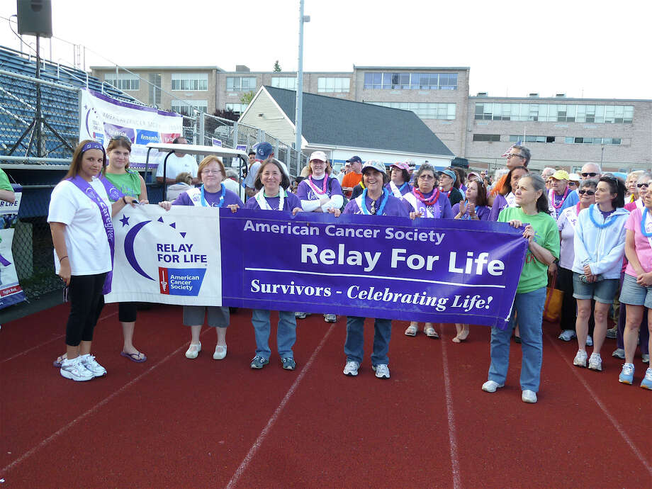 At last year's Relay for Life at Fairfield Ludlowe High School, participants and spectators gathered for the opening ceremonies. Organizers estimate more than 4,000 participants and spectators were drawn to Ludlowe's track last year. Photo: Contributed Photo/Mike Lauterbor, File Photo / Fairfield Citizen contributed