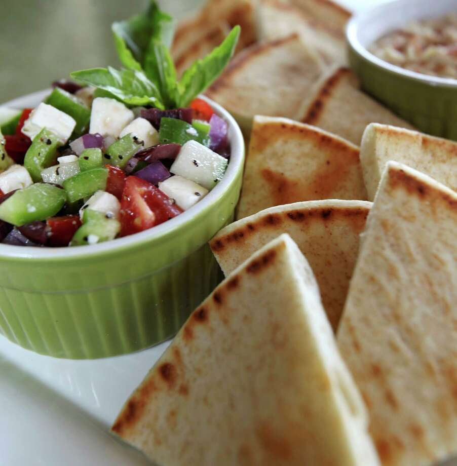 "The Mediterranean Platter at Picnikins is a fresh cucumber salad and hummus with pita bread. Owner Cheryl Bezuidenhout has been serving the dish since the restaurant's opening two years ago but has noticed a gradual recent popularity of the dish because of it's freshness and lightness that makes it a ""good spring and summer dish in San Antonio."" Photo: Julysa Sosa, San Antonio Express-News / © 2012 San Antonio Express-News"