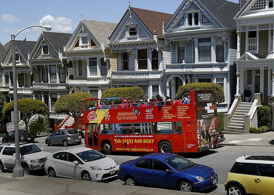 "An open top bus stopped in front of the ""painted ladies"" Victorian home attraction on the east side of Alamo Square. Some tour buses have been ""misbehaving"" around the popular tourist attraction at Alamo Square in San Francisco, Calif. Photo: Brant Ward, The Chronicle"