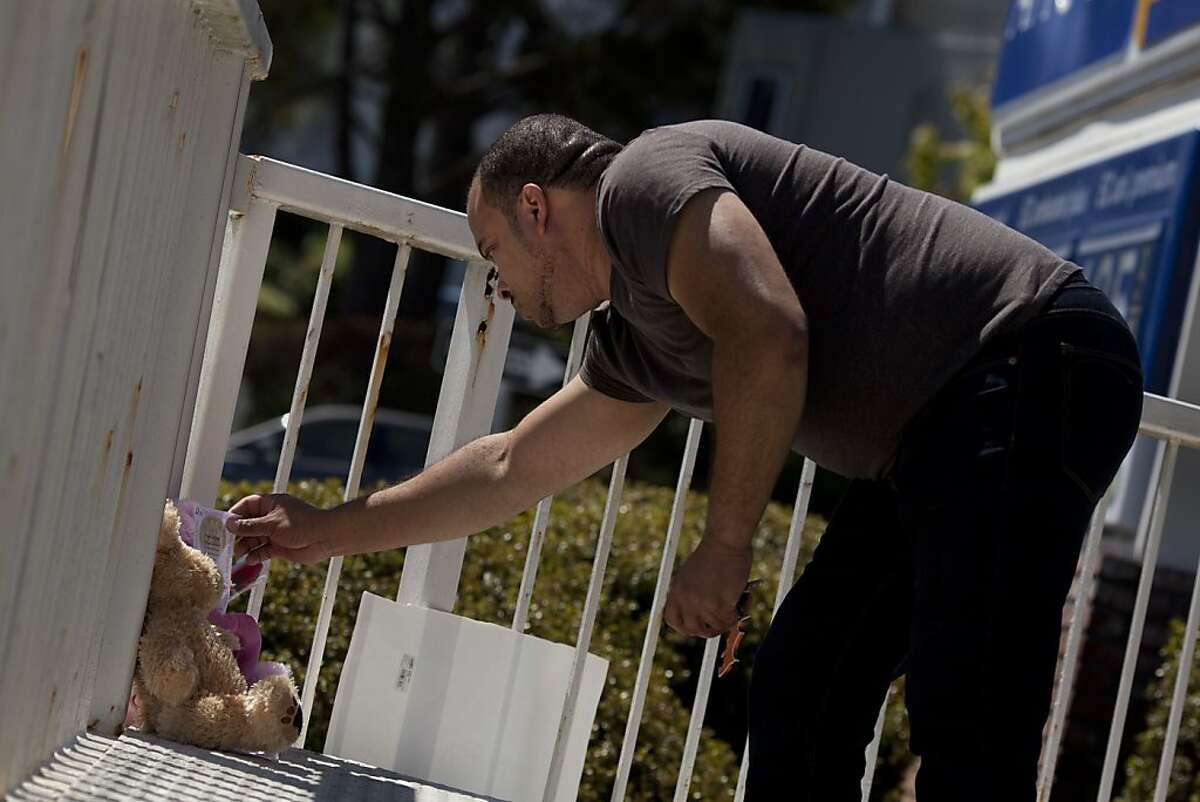 A visitor comes to pay respoects to the memorial for Derrick Gaines, 15, who was shot by Police on Wednesday, June 7, 2012 in South San Francisco, Calif.