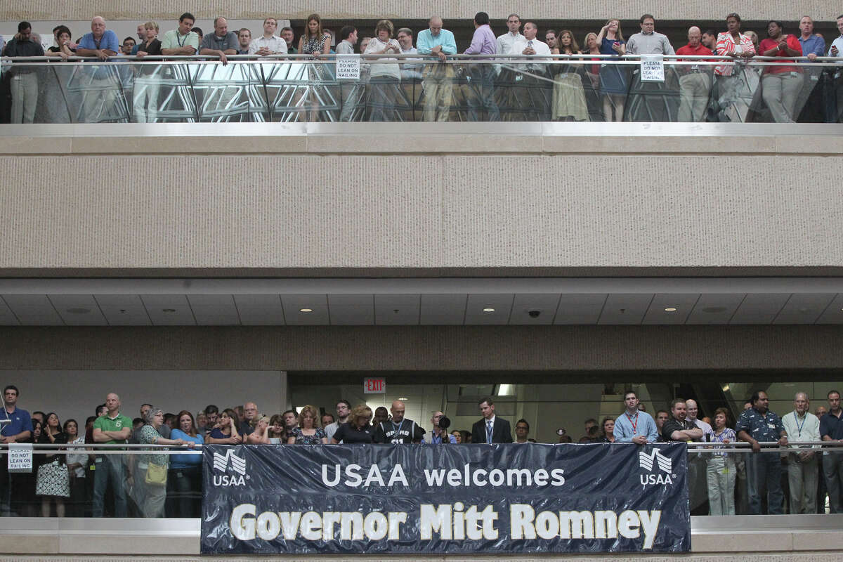 Employees at USAA await the arrival of Republican presidential hopeful Mitt Romney Wednesday, June 6, 2012.