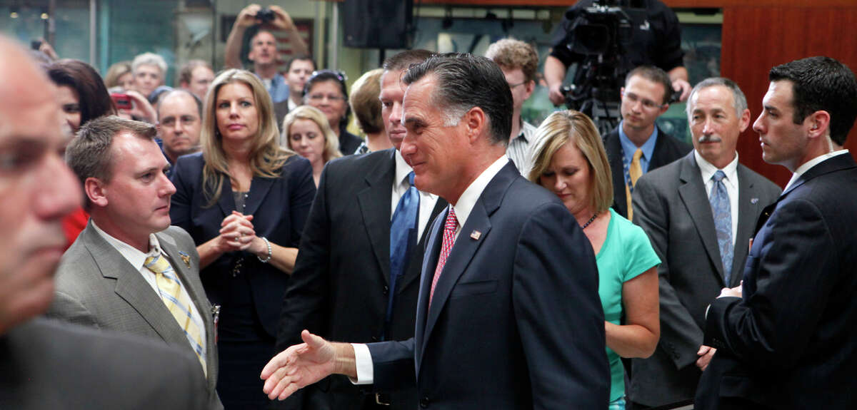 Mitt Romney greets employees at USAA in a campaign event on Wednesday, June 6, 2012. While there and at a luncheon at the Marriott Rivercenter, he talked military spending, health care and job creation.