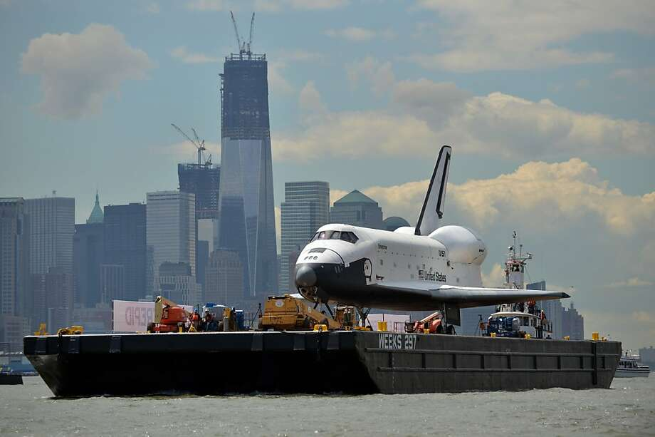 The space shuttle Enterprise is towed by barge past lower Manhattan in New York June 6, 2012 on its way to the Intrepid Sea, Air and Space Museum where it will be permanently displayed. AFP PHOTO/Stan HONDASTAN HONDA/AFP/GettyImages Photo: Stan Honda, AFP/Getty Images