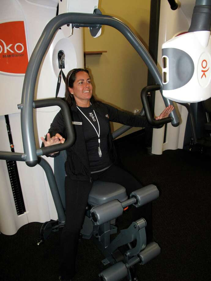 Stephanie Weinstein, master fitness coach at the new Koko FitClub, demonstrates the strength equipment. Photo by Ian Brash, June 8, 2012, Darien, Conn. Photo: Contributed Photo