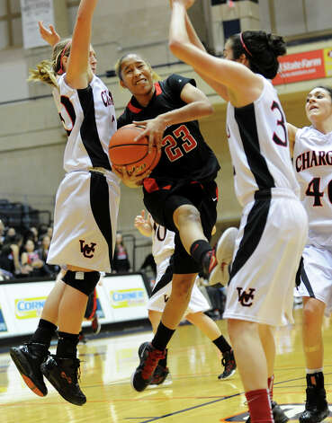 Wagner's Adriane Davis (23) tries to take a shot between Churchill's Leslie Vorpahl (left) and Danielle Espinoza (right) during a UIL 5A girls third-round playoff game between the Thunderbirds and the Chargers at the UTSA Convocation Center on Feb. 20, 2012. Photo: John Albright / For The Express-News