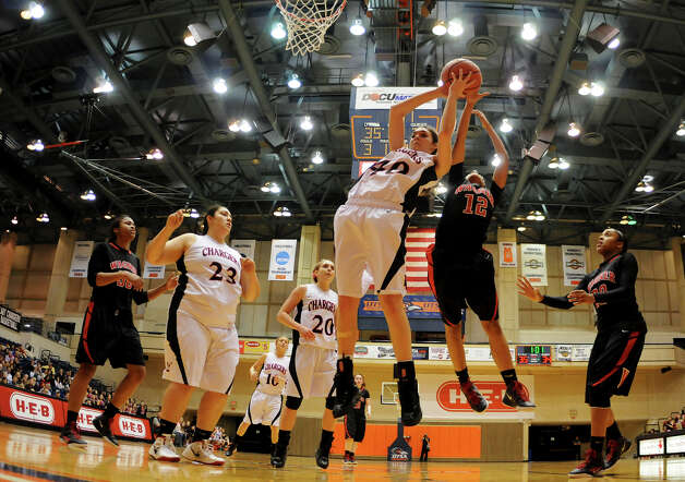 Churchill's Rebecca Flores (40) grabs a rebound in front of Wagner's Aundrea Davis (12) during a UIL 5A girls third-round  playoff game between the Thunderbirds and the Chargers at the UTSA Convocation Center on Feb. 20, 2012. Photo: John Albright / For The Express-News