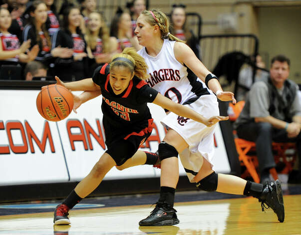 Churchill's Leslie Vorpahl (20) tries to steel the ball from Wagner's Adriane Davis (23) during a UIL 5A girls third-round playoff game between the Thunderbirds and the Chargers at the UTSA Convocation Center on Feb. 20, 2012. Photo: John Albright / For The Express-News